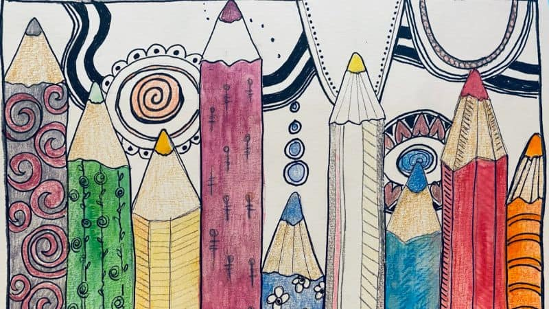 colorful pencils lined up with mindful zen dooles across the top of the page.