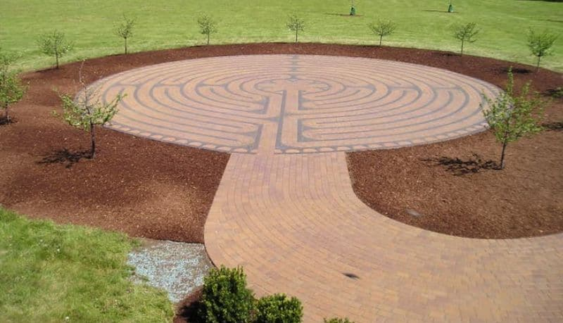 photo of brick path 11-circuit labyrinth surrounded by red earth and green grass